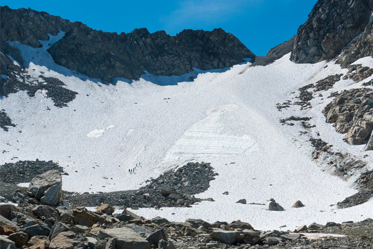 People walk a glacier during a Glacier Discovery TourTour