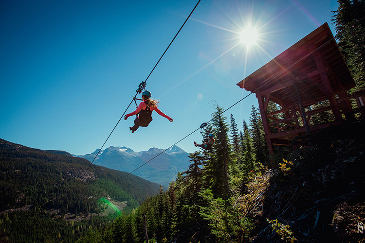 Woman ziplining in Whistler