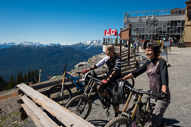 Two women chatting at Whistler Mountain Bike Park