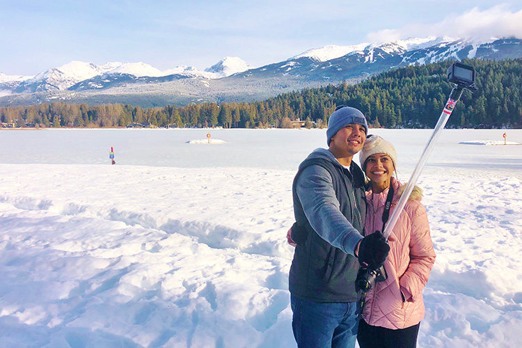 Couple takes a selfie in front of Alta Lake in Whistler