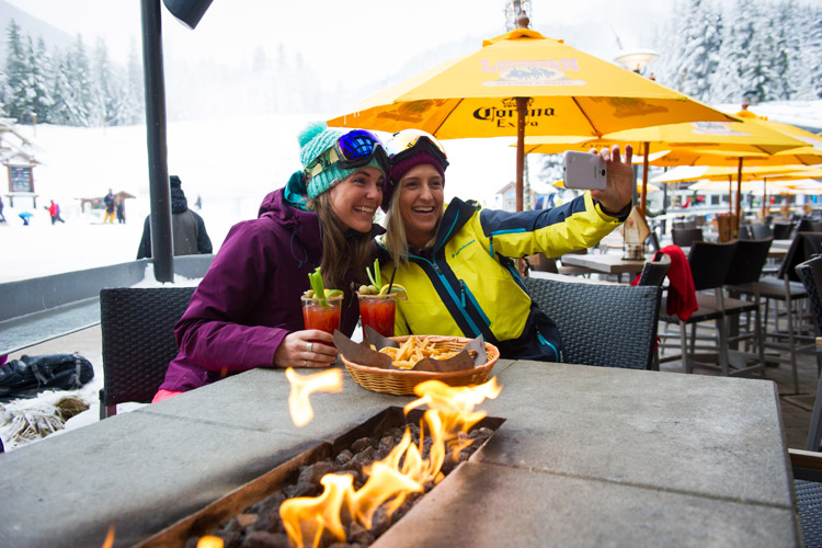 Friends taking a selfie and enjoying apres at the Longhorn in Whistler