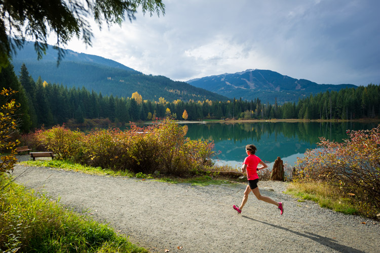 Runner enjoying fall scenery at the Whistler 50 and Ultra Marathon