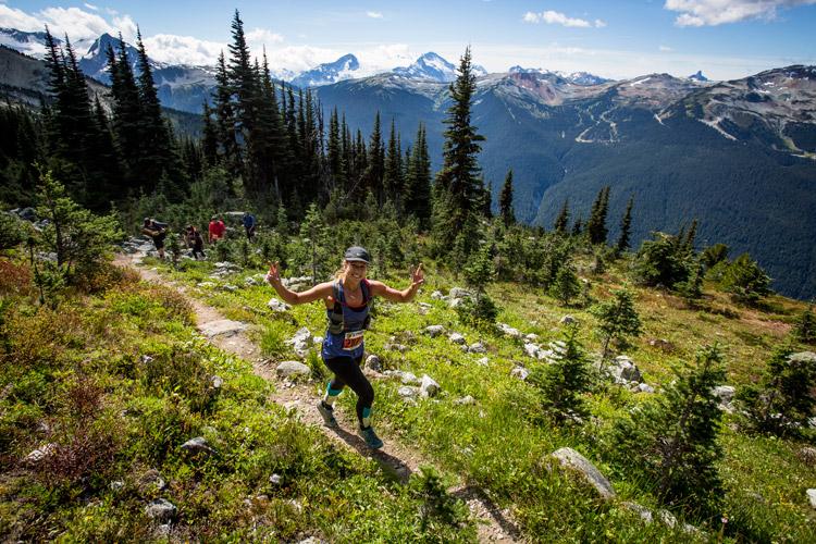 Smiling runner during the 5 Peaks trail running series in Whistler