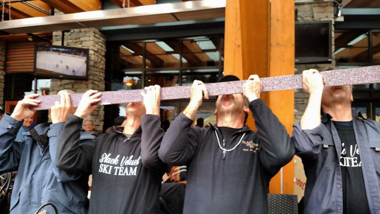 The Black Velvet Team using their shot ski and apres
