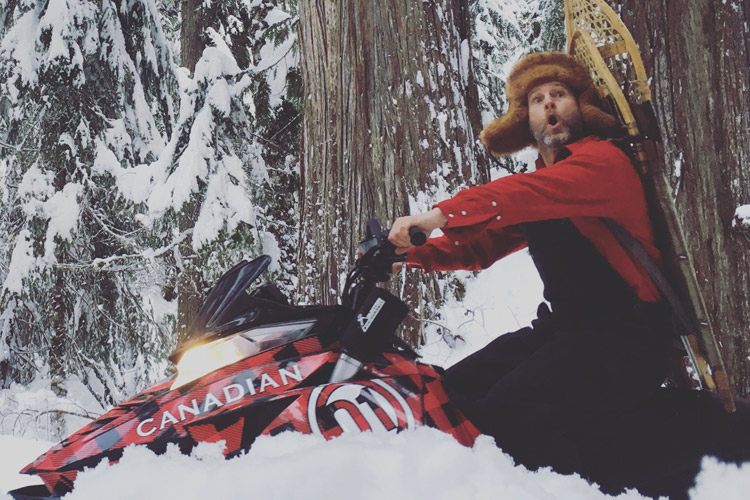 Canadiana Man Snowmobiling in Whistler