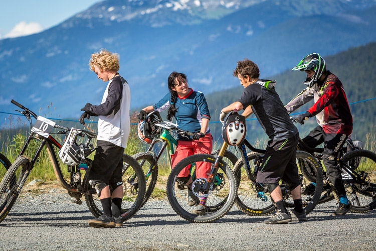 Mountain bikers socializing at the top of the trail