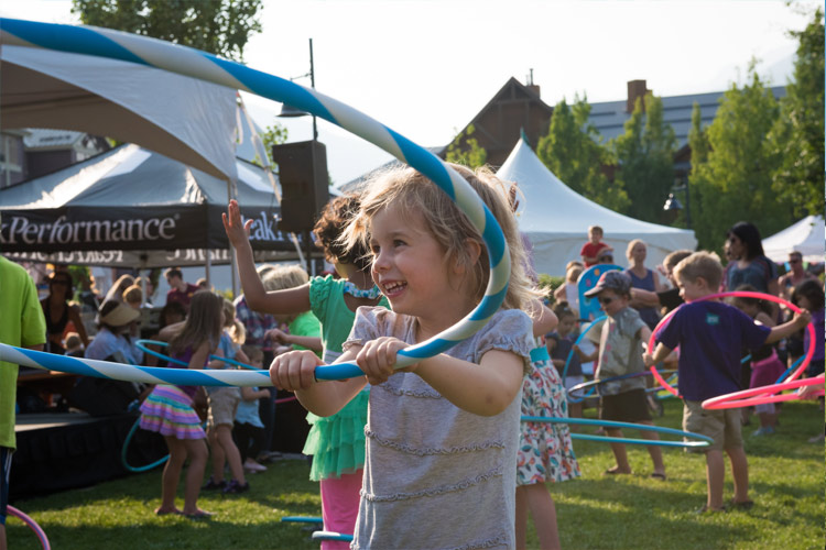 Child hula hooping at the Whistler Childrens Festival