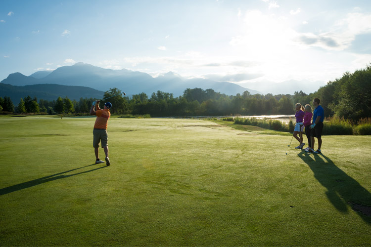 Golfer swings at Big Sky golf Course Pemberton