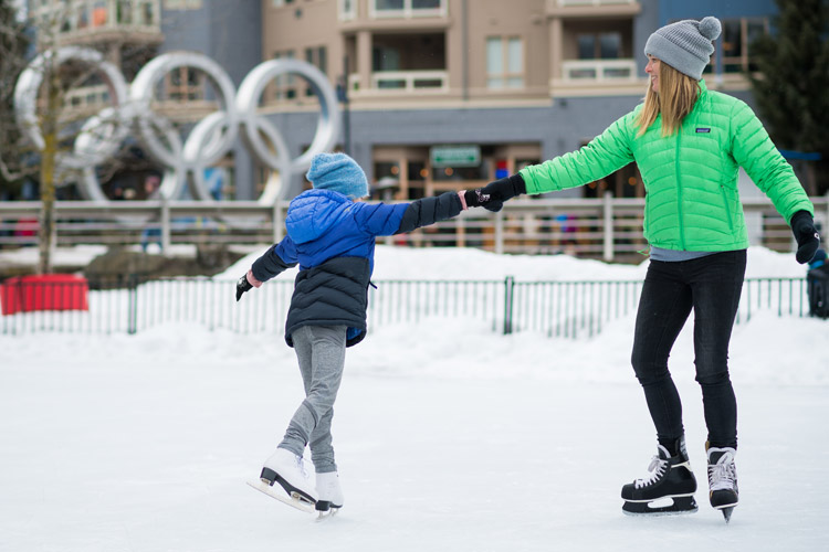 Family skating at Olympic Plaza
