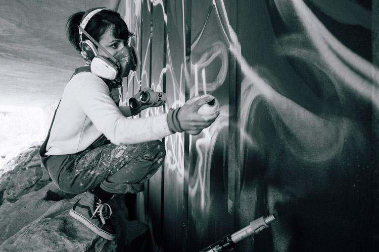 Artist Jessa Gilbert Painting the Creekside Underpass Mural