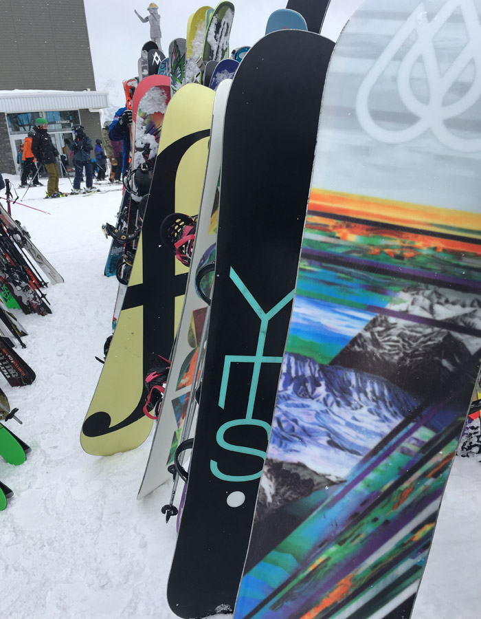 Snowboards on the rack on Whistler Mountain.