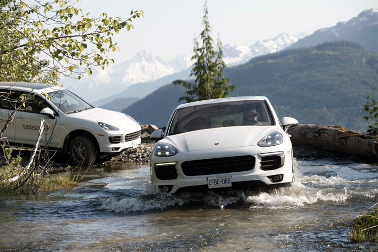 Porsche crossing a water feature in the Callaghan Valley