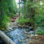 ATVs splash through a creek in Whistler.