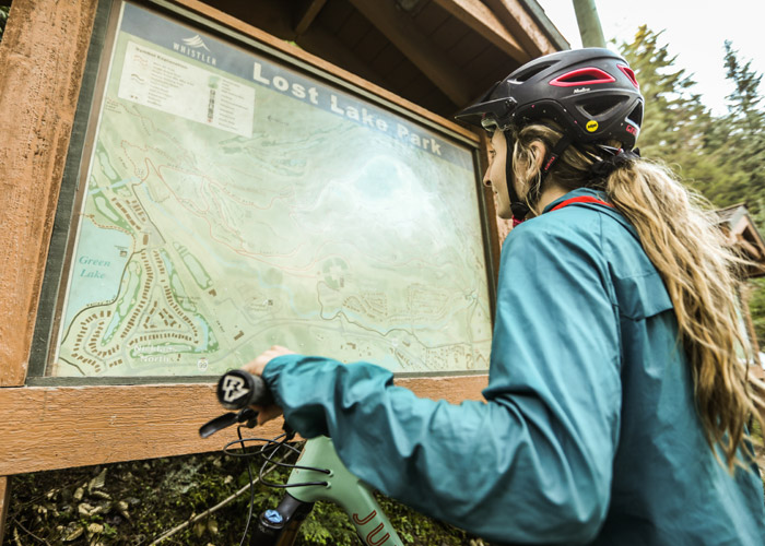 Looking at the trail map at Lost lake.