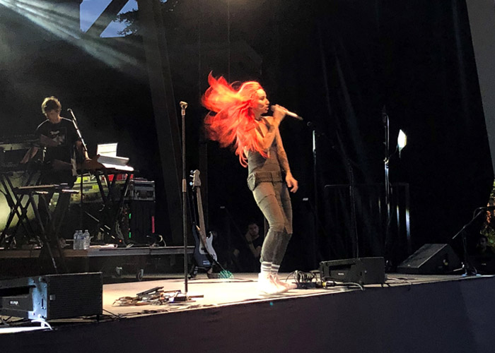 Red hair flowing on stage at Whistler Presents.
