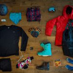 Gear laid out from above for what essentials to pack for whistler.