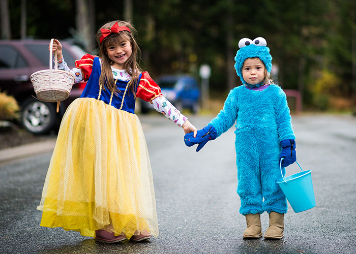 Two children are dressed up for Halloween trick-or-treating in Whistler.