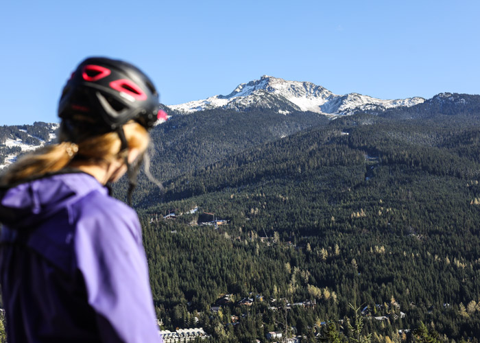 A mountain biker admires the views over Whistler Mountain from the Westside trails.