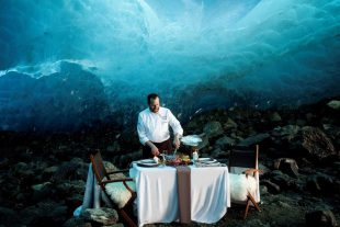 A chef prepares dinner in an ice cave during Whistler's Cornucopia festival.