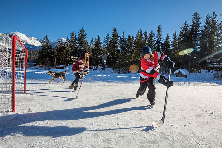 kids playing pond hockey in Whistler