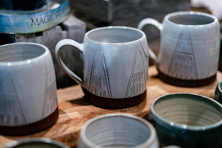 Handmade mugs with mountains designs.