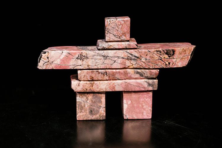 Stone inuksuk sculpture.