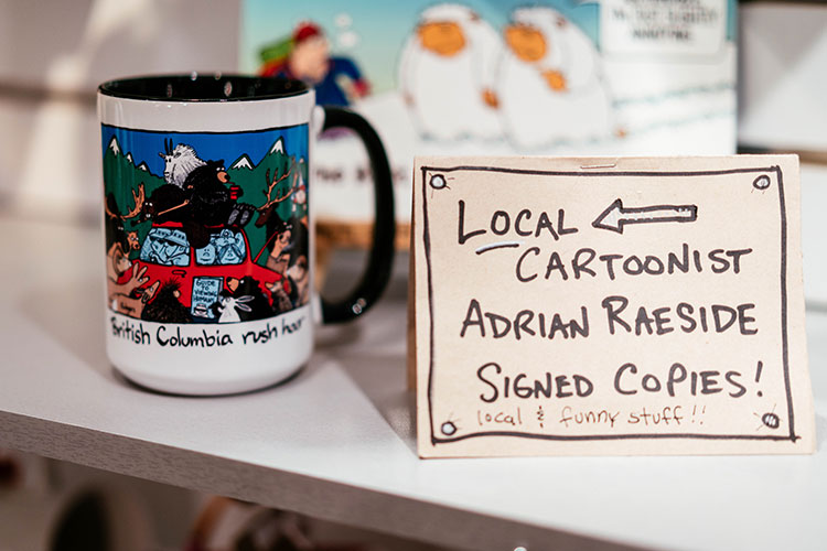 A mug with bear cartoon by local artist Adrian Raeside.