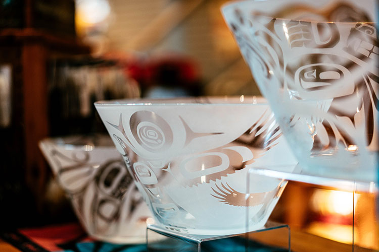 Three etched glass bowls by First Nations artist Ron Wallace.