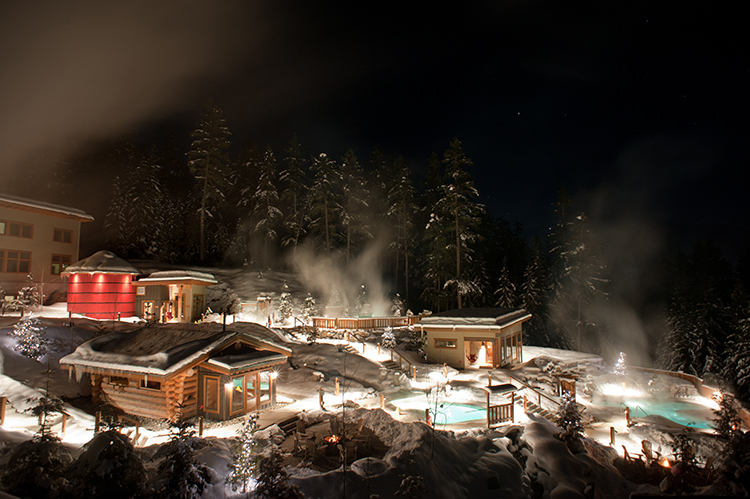 The Scandinave Spa lit up at night
