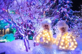 Festive characters pose under the lights in Whistler.