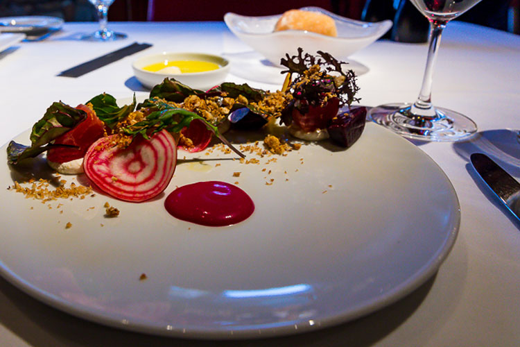 A plate showcasing the Rootdown Farm Beet Salad at Araxi.