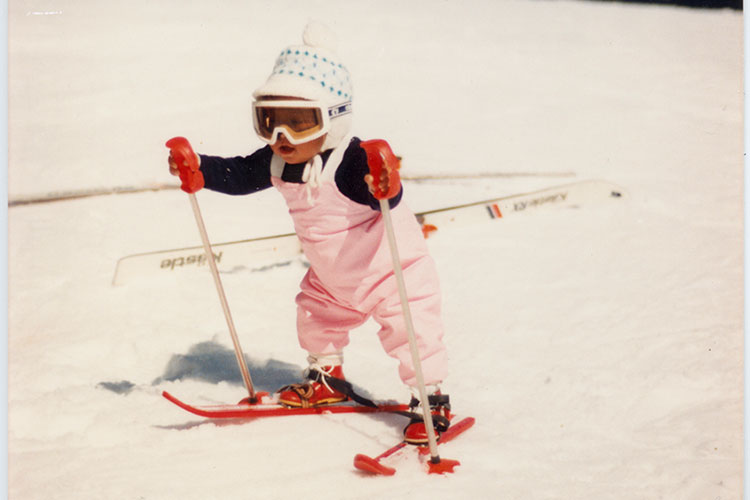 A tot skier in a pink outfit takes to the slopes in Whistler.