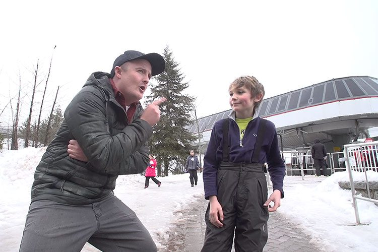 Brandon chats to a young man about why he came to Whistler.