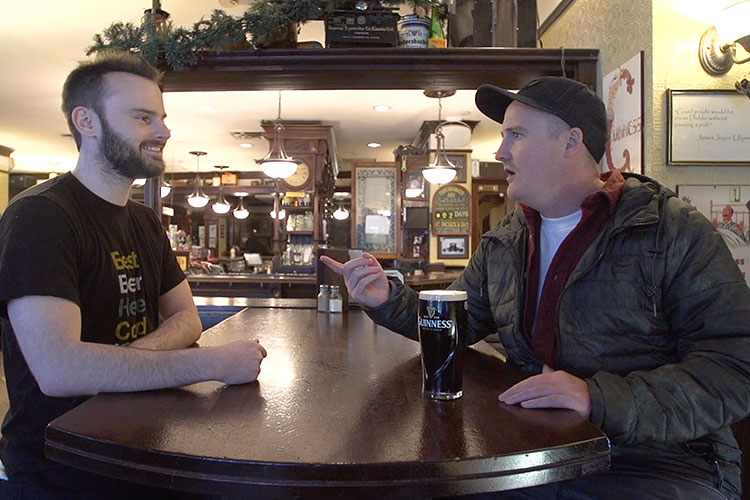 Brandon chats with a server at the Dubh Linn Gate about why he came to Whistler.