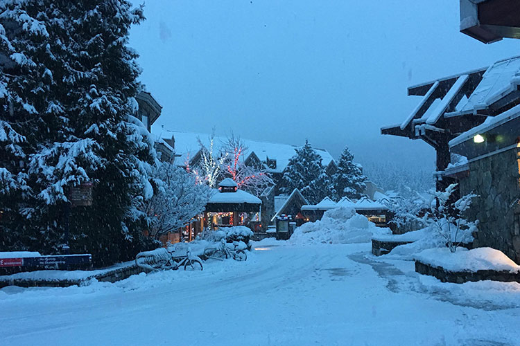 Thick snow on buildings in Whistler Village.