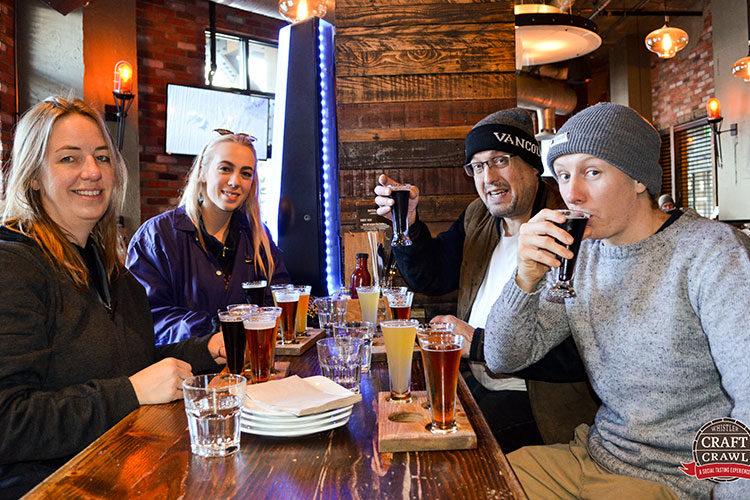 A group of friends sample beers at Brickworks in Whistler.