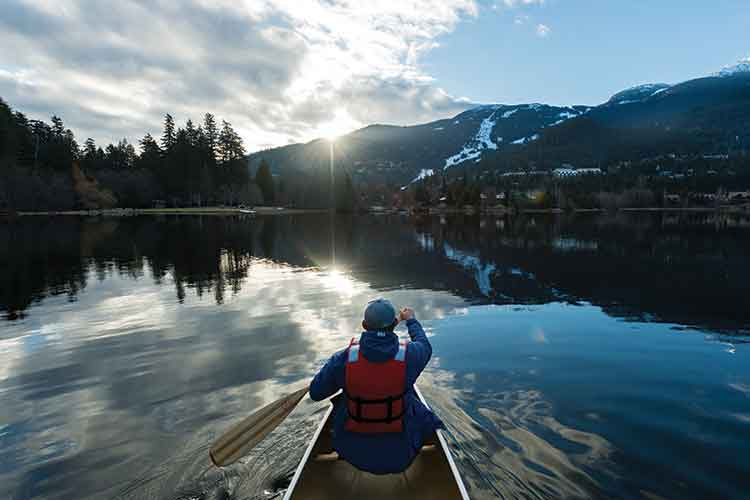 Canoe on a glassy smooth lake.