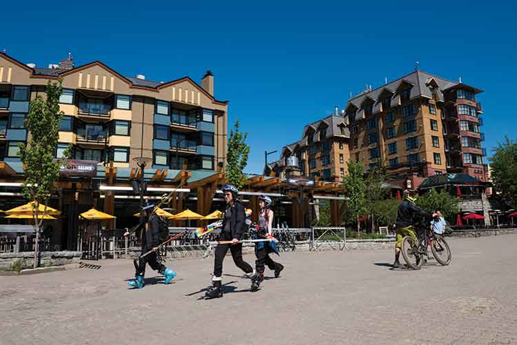 skiers and bikers in Whistler Village