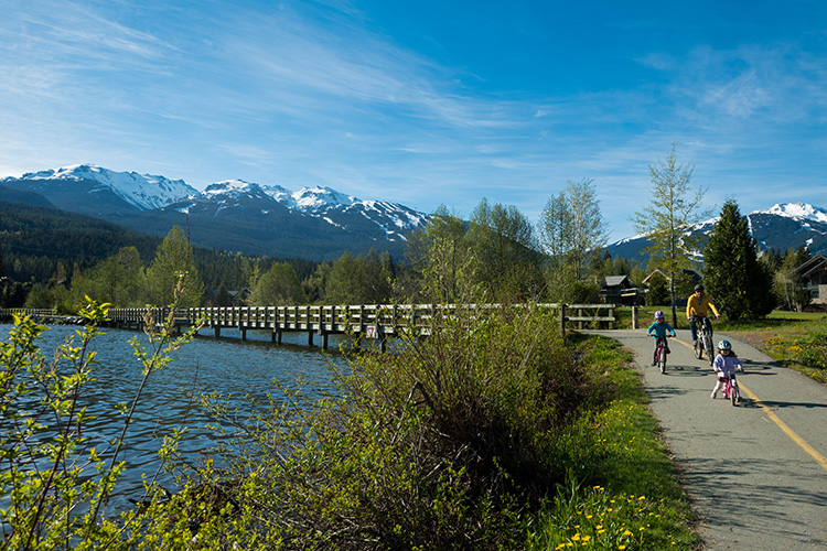 Family riding bikes on the Valley Trail in Whistler