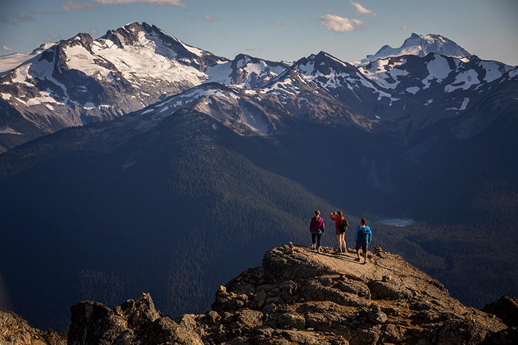 Hikers overlooking a mountain view in Whistler