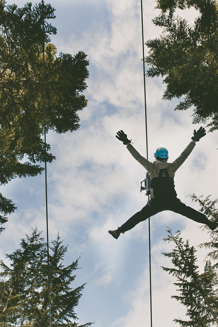 Person ziplining through the trees in Whistler