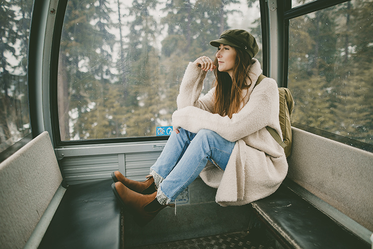 Woman sitting in Whistler Gondola