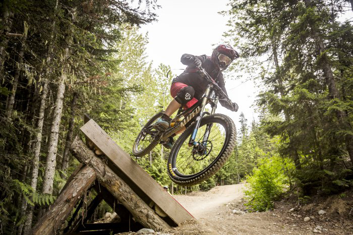 Mountain biker on a feature in the Whistler Mountain Bike Park