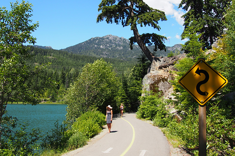 Woman walking the Valley Trail in Whistler