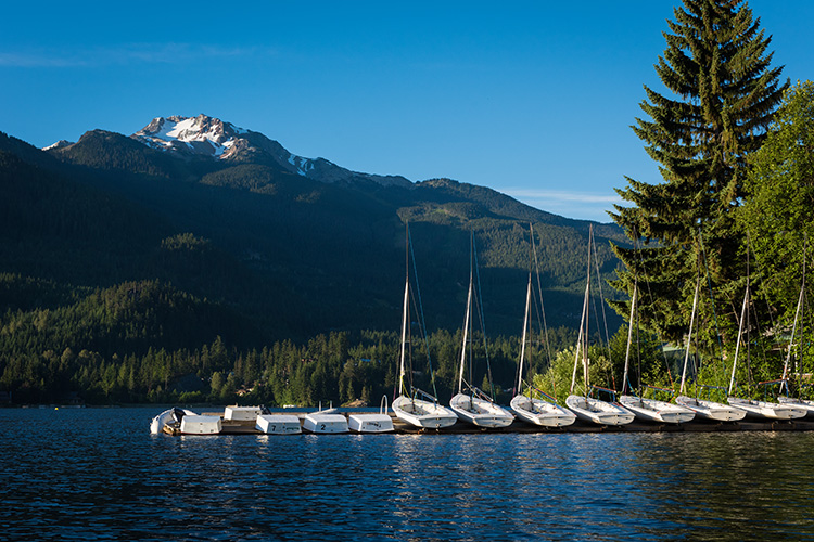 Sailboats lined up on Alta Lake in Whistler