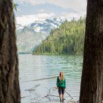 Hiker standing on log in Cheakamus Lake