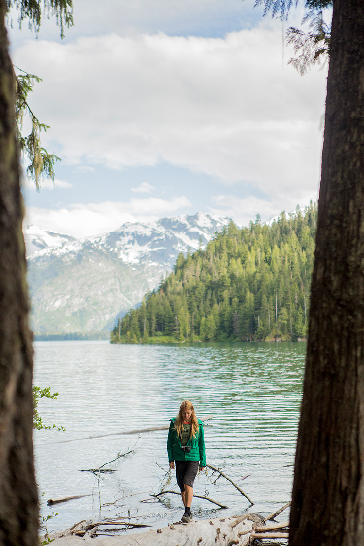 Hiker standing on a log in Cheakamus Lake