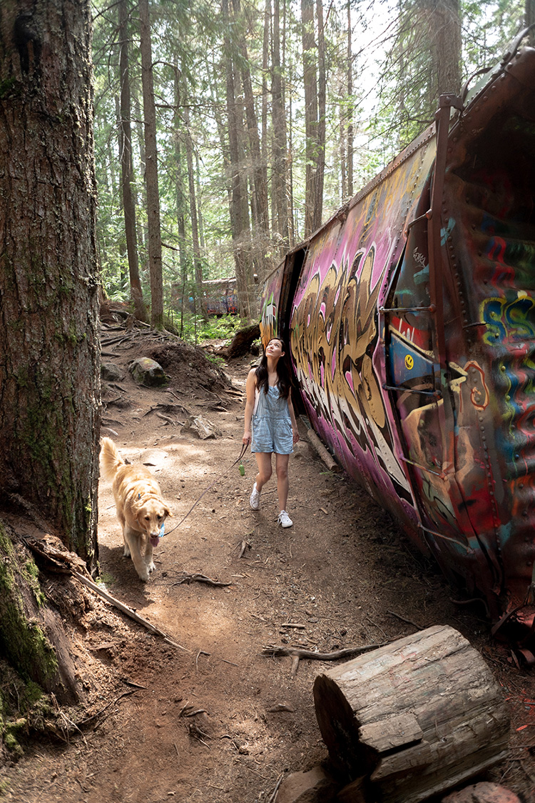Woman walking her dog at Train Wreck in Whistler