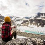 Hiker having a coffee at Wedgemount Lake