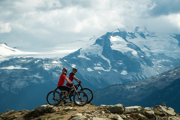 Two mountain bikers on Top of the World trail in Whistler